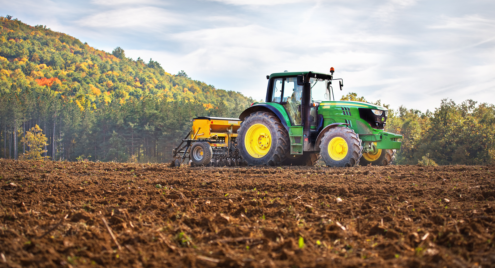 Rish Bulgaria - Octomber 26th 2015 Ploughing a field with John Deere 6930 tractor. John Deere 8100 was manufactured in 1995-1999 and it has JD 7.6L or 8.1L 6-cyl diesel engine.